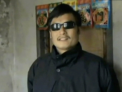 FILE - In this Jan. 2011 image made from video released on Feb. 10, 2011, by China Aid Association, Chinese activist and lawyer Chen Guangcheng speaks in Dongshigu village, Shandong province, China. A blind Chinese activist, Chen Guangcheng, under house arrest was beaten into unconsciousness by local authorities and denied medical care, his wife said in a handwritten letter that was smuggled out of the couple's tightly guarded home. (AP Photo/China Aid Association)