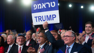 Supporters hold signs as US President Donald Trump speaks during the Republican Jewish Coalition 2019 Annual Leadership Meeting in Las Vegas, Nevada, April 6, 2019. (Photo by SAUL LOEB / AFP) (Photo credit should read SAUL LOEB/AFP via Getty Images)