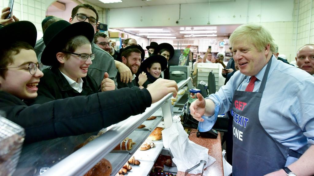 Boris-Johnson-wears-a-Get-Brexit-Done-apron-as-he-makes-donuts-Grodzinski-Bakery-in-Golders-Green-on-December-6-2019[1]