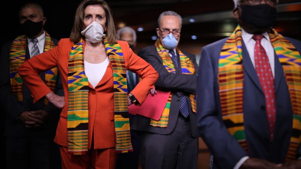 Pelosi, African mask wearers